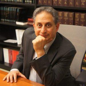 Cyrus Mehri sitting at desk