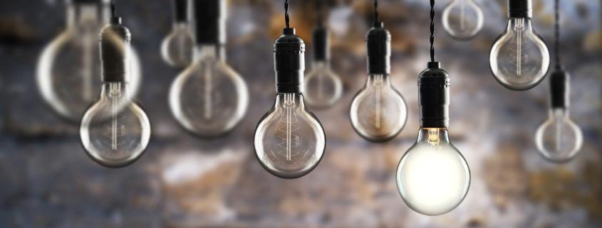 industrial themed light bulbs against masonry wall