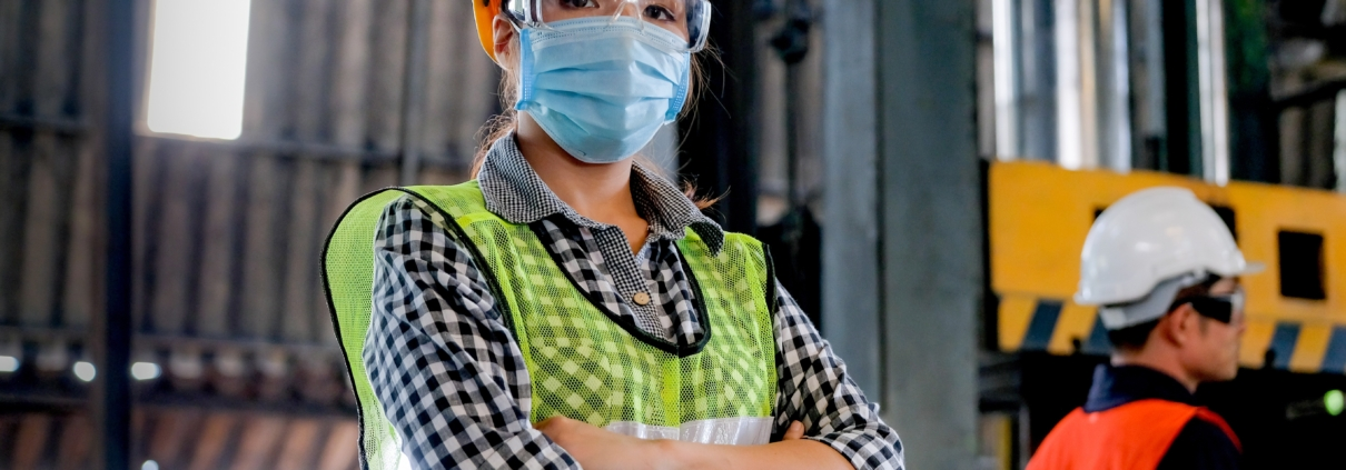 woman factory worker with hygienic mask during COVID19
